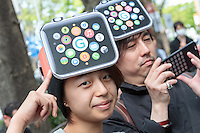 Makoto Saito (left) and Kazumi Oda (right) wear Apple watch hats as they wait to buy the product on its officail release at the Softbank Store in Omotesando, Tokyo, Japan. Friday April 24th 2015. Apple's long anticipated  smart watch was officially put on sale in stores in just nine countries. Japan and Australia which are furthest east were the first places in the world where this watch was available for purchase.
