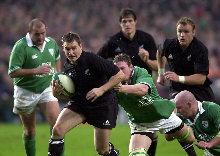Photo. Richard Lane. .Ireland v New Zealand at Lansdowne Road, Dublin. 17-11-2001.Andrew Mehertens gets away from the Irish tacklers.