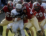 (Cambridge Ma 11/22/14) Yale 30, Tyler Varga, is swallowed up by  Harvard defense in the first half, including Harvard 22, Asante Gibson, as Harvard defeated Yale 31-24. Jim Michaud Photo