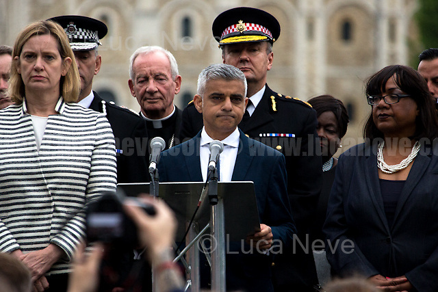 London, 05/06/2017. Today, members of the public, politicians, multi-faith leaders, ambassadors, tourists and police gathered at the vigil in Potters Field Park near City Hall (about a mile from London Bridge and Borough Market) to remember the seven victims of the 3rd of June London Bridge &amp; Borough Market terrorist attack.The commemoration ceremony was led by London's Mayor Sadiq Khan, Secretary of State Amber Rudd MP, Shadow Secretary of State Diane Abbott MP. Other guests included: MET Police Commissioner Cressida Dick, Commissioner Ian Dyson and commander Jane Gyford from City of London Police, Archbishop of Canterbury Justin Welby, Chief Rabbi Ephraim Mirvis and leaders and members of London's Muslim community.<br /> <br /> On 03 June 2017, at around 21:58, a terrorist attack took place in London Bridge &amp; Borough Market, London. The attack began when a white van mounted the pavement and run into pedestrians from the north side of London Bridge. Then, the van stopped on the south of the bridge and the three men (Shazad Butt - 20 April 1990 - a British citizen born in Pakistan, Rachid Redouane - 31 July 1986 - who claimed to be either Moroccan or Libyan and who was not previously known to police, and Youssef Zaghba, 22-year-old of Moroccan-Italian descent who lived in east London and was not a police or MI5 subject of interest), wielding knives and wearing fake explosive vests, ran to Borough Market, where they stabbed people inside restaurants. Ten people (including three attackers) were killed and 48 injured in the attack. Three suspects were shot dead by police. (Caption Updated: 06 June 2017).<br /> <br /> For more information please click here: https://en.wikipedia.org/wiki/June_2017_London_attack &amp; http://www.bbc.co.uk/news/live/uk-40147014<br /> <br /> For more information about the event please click here: https://www.london.gov.uk/events/2017-06-05/vigil-honour-victims-london-bridge-terrorist-attack