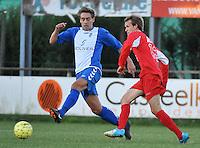 KSV Rumbeke : Nicolas Debusscher met de tackle voor Davy Ghekiere van De Ruiter (rechts)<br /> foto VDB / Bart Vandenbroucke