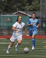Boston Aztec forward Brittany Russo (3) brings the ball forward.  In a Women's Premier Soccer League (WPSL) match, Boston Aztec (white) defeated Seacoast United Mariners (blue), 2-1, at North Reading High School Stadium on Arthur J. Kenney Athletic Field on on June 23, 2013. Due to injuries through the season, Seacoast United Mariners could only field 10 players.