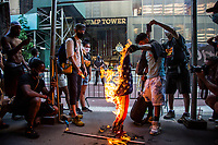 NEW YORK, NY - JULY 4: A group of protesters burn a flag of the United States in front of the Trump Tower during a Black Lives Matter protest in New York, NY on July 4, 2020. Protests continue in New York and all movements and actions take place in the context of protests against the murder of George Floyd and other African Americans by the police in the United States. (Photo by Pablo Monsalve / VIEWpress via Getty Images)
