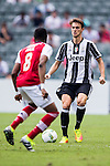 Juventus' player Daniele Rugani contests the ball against South China's player Mahama Awai during the South China vs Juventus match of the AET International Challenge Cup on 30 July 2016 at Hong Kong Stadium, in Hong Kong, China.  Photo by Marcio Machado / Power Sport Images
