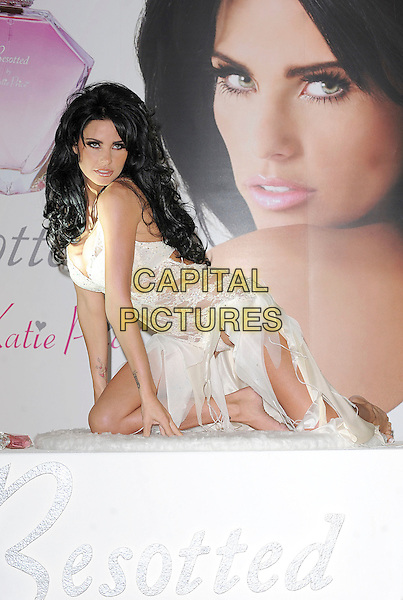 "KATIE PRICE aka JORDAN .launches her new perfume""Besotted"", Cafe Royal, London, England,.24th September 2008..fragrance full length white lace lingerie sheer kneeling bra black hair extensions   .CAP/BEL.©Tom Belcher/Capital Pictures"