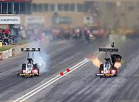 Jul. 19, 2014; Morrison, CO, USA; NHRA top fuel driver J.R. Todd (right) races alongside Doug Kalitta during qualifying for the Mile High Nationals at Bandimere Speedway. Mandatory Credit: Mark J. Rebilas-