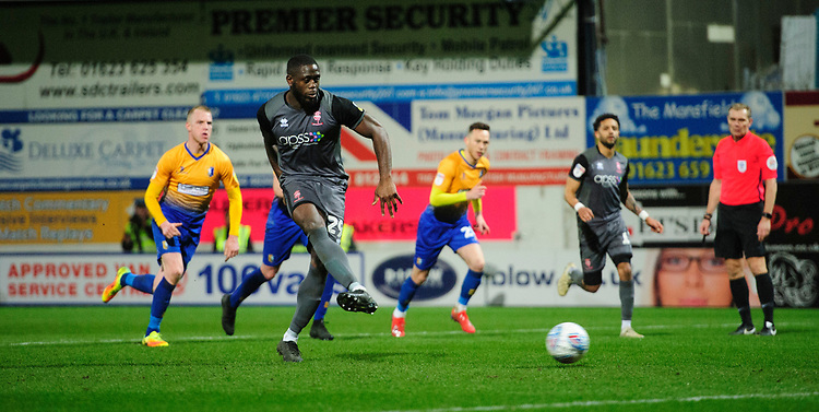 Lincoln City's John Akinde scores his side's equalising goal, from the penalty spot, to make the score 1-1<br /> <br /> Photographer Chris Vaughan/CameraSport<br /> <br /> The EFL Sky Bet League Two - Mansfield Town v Lincoln City - Monday 18th March 2019 - Field Mill - Mansfield<br /> <br /> World Copyright © 2019 CameraSport. All rights reserved. 43 Linden Ave. Countesthorpe. Leicester. England. LE8 5PG - Tel: +44 (0) 116 277 4147 - admin@camerasport.com - www.camerasport.com