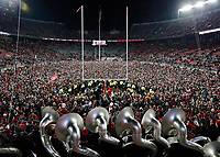Ohio State Buckeyes fans rushed the field after beating Penn State Nittany Lions 39-38 during their game in Ohio Stadium on October 28, 2017.  [Kyle Robertson/Dispatch]