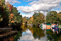 Late afternoon sun lights up the Fall foliage at Chaffeys Lock on the Rideau Canal in Ontario