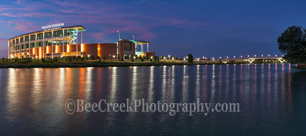 Another capture in of the McLane Stadium with the building and pedestrian bridge in a pano with the lights on against a twilight blue hour sky with  clouds left over from sunset for a stunning look.  The Brazos river capture some nice reflections from the lights of the McLane Stadium where the Baylor University Bears play their games.  We capture this as a panorama so you can also see the the pedestrian bridge that crosses over the Brazos river from the Baylor campus in this panorama.