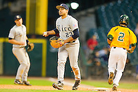 First baseman Anthony Rendon #23 of the Rice Owls checks the runner at third base after Steve DalPorto #2 of the Baylor Bears had grounded out at Minute Maid Park on March 6, 2011 in Houston, Texas.  Photo by Brian Westerholt / Four Seam Images