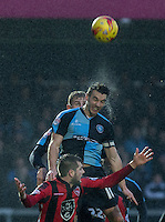 Matt Bloomfield of Wycombe Wanderers wins the ball in the rain during the Sky Bet League 2 match between Wycombe Wanderers and Morecambe at Adams Park, High Wycombe, England on 2 January 2016. Photo by Andy Rowland / PRiME Media Images