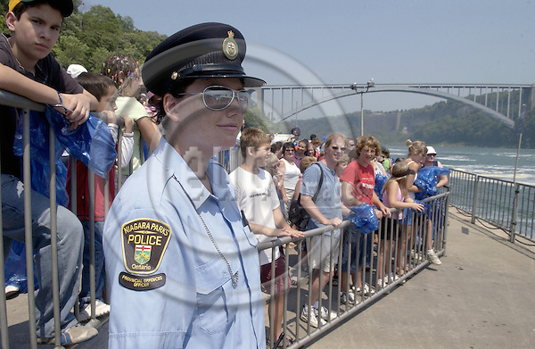 Niagara Falls, Ontario, Canada - 01 August 2006---A provincial offences officer of the Niagara Parks Police, supervising tourists / visitors  lining up for a cruise on the Niagara River---people, tourism---Photo: Horst Wagner / eup-images