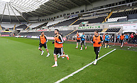 Wednesday, 23 April 2014<br /> Pictured: Players take to the pitch.<br /> Re: Swansea City FC are holding an open training session for their supporters at the Liberty Stadium, south Wales,