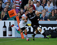 20130809 Copyright onEdition 2013 ©<br /> Free for editorial use image, please credit: onEdition.<br /> <br /> Chris Harris of Newcastle Falcons 7s scores a try during the finals of the J.P. Morgan Asset Management Premiership Rugby 7s Series.<br /> <br /> The J.P. Morgan Asset Management Premiership Rugby 7s Series kicked off for the fourth season on Thursday 1st August with Pool A at Kingsholm, Gloucester with Pool B being played at Franklin's Gardens, Northampton on Friday 2nd August, Pool C at Allianz Park, Saracens home ground, on Saturday 3rd August and the Final being played at The Recreation Ground, Bath on Friday 9th August. The innovative tournament, which involves all 12 Premiership Rugby clubs, offers a fantastic platform for some of the country's finest young athletes to be exposed to the excitement, pressures and skills required to compete at an elite level.<br /> <br /> The 12 Premiership Rugby clubs are divided into three groups for the tournament, with the winner and runner up of each regional event going through to the Final. There are six games each evening, with each match consisting of two 7 minute halves with a 2 minute break at half time.<br /> <br /> For additional images please go to: http://www.w-w-i.com/jp_morgan_premiership_sevens/<br /> <br /> For press contacts contact: Beth Begg at brandRapport on D: +44 (0)20 7932 5813 M: +44 (0)7900 88231 E: BBegg@brand-rapport.com<br /> <br /> If you require a higher resolution image or you have any other onEdition photographic enquiries, please contact onEdition on 0845 900 2 900 or email info@onEdition.com<br /> This image is copyright the onEdition 2013©.<br /> <br /> This image has been supplied by onEdition and must be credited onEdition. The author is asserting his full Moral rights in relation to the publication of this image. Rights for onward transmission of any image or file is not granted or implied. Changing or deleting Copyright information is illegal as specified in the Copyright, Design and Patents Act 1988. If you are in any way unsure of your right to publish this image plea