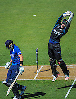 Luke Ronchi leaps up to take a return during the ICC Cricket World Cup one day pool match between the New Zealand Black Caps and England at Wellington Regional Stadium, Wellington, New Zealand on Friday, 20 February 2015. Photo: Dave Lintott / lintottphoto.co.nz