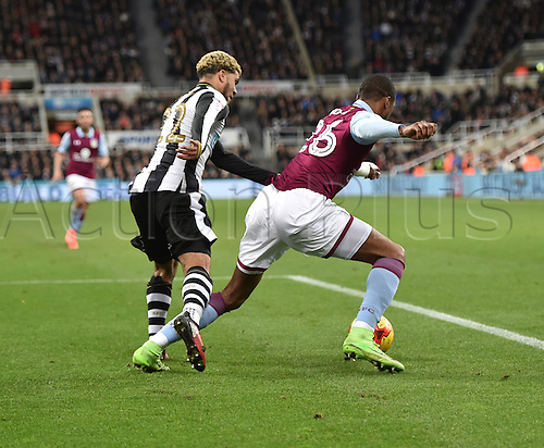 February 20th 2017, St James Park, Newcastle, England; Skybet Championship football, Newcastle versus Aston Villa; Jonathan Kodjia of Aston Villa shields the ball from DeAndre Yedlin of Newcastle United