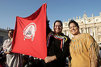 Nativi americani attendono l'inizio della cerimonia di canonizzazione di Kateri Tekakwitha, insieme ad altri sei nuovi santi, in Piazza San Pietro, Citta' del Vaticano, 21 ottobre 2012..Native American Indians hold a flag portraying Kateri Tekakwitha in St. Peter square prior to take part in a canonization ceremony at the Vatican, 21 October 2012. Kateri Tekakwitha, a 17th-century Mohawk Indian who spent most of her life in what is now upstate New York, was declared a saint along with six others in a ceremony attended by the Pope..UPDATE IMAGES PRESS/Riccardo De Luca