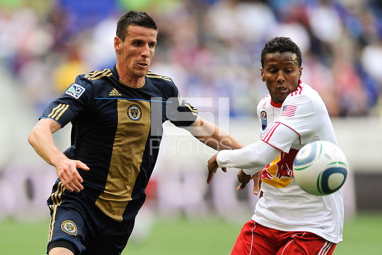 Sebastien Le Toux (9) of the Philadelphia Union and Danleigh Borman (11) of the New York Red Bulls battle for the ball. The New York Red Bulls defeated the Philadelphia Union 2-1 during a Major League Soccer (MLS) match at Red Bull Arena in Harrison, NJ, on April 24, 2010.