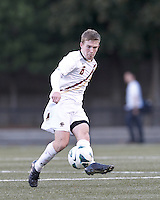 Boston College midfielder Jason Abbott (6) passes the ball. Brown University (black) defeated Boston College (white), 1-0, at Newton Campus Field, October 16, 2012.