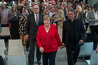 """Veranstaltung """"50 Jahre Entwicklungshelfer-Gesetz – 'Die Welt im Gepaeck'"""" am Freitag den 12. Juli 2019 in der Berliner St. Elisabethkirche.<br /> Als Gast war die Bundeskanzlerin Angela Merkel geladen.<br /> Den Ehrentag fuer zurueckgekehrte Entwicklungshilfe-Fachkraefte veranstalten die Gemeinsame Konferenz Kirche und Entwicklung (GKKE) und die Arbeitsgemeinschaft der Entwicklungsdienste (AGdD).<br /> Im Bild: Praelat Martin Dutzmann, GKKE; Bundeskanzlerin Angela Merkel; Praelat Karl Juesten.<br /> 12.7.2019, Berlin<br /> Copyright: Christian-Ditsch.de<br /> [Inhaltsveraendernde Manipulation des Fotos nur nach ausdruecklicher Genehmigung des Fotografen. Vereinbarungen ueber Abtretung von Persoenlichkeitsrechten/Model Release der abgebildeten Person/Personen liegen nicht vor. NO MODEL RELEASE! Nur fuer Redaktionelle Zwecke. Don't publish without copyright Christian-Ditsch.de, Veroeffentlichung nur mit Fotografennennung, sowie gegen Honorar, MwSt. und Beleg. Konto: I N G - D i B a, IBAN DE58500105175400192269, BIC INGDDEFFXXX, Kontakt: post@christian-ditsch.de<br /> Bei der Bearbeitung der Dateiinformationen darf die Urheberkennzeichnung in den EXIF- und  IPTC-Daten nicht entfernt werden, diese sind in digitalen Medien nach §95c UrhG rechtlich geschuetzt. Der Urhebervermerk wird gemaess §13 UrhG verlangt.]"""
