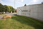 Sign on wall at entrance to Cambridge Business Park, Cambridge, England