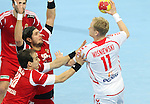 21.01.2013 Barcelona, Spain. IHF men's world championship, Eighth Final. Picture show Wisniewski  in action during game Hungary vs Poland at Palau St Jordi