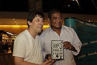 """FOTO EMBARGADA PARA VEICULOS INTERNACIONAIS - SAO PAULO, SP, 07 DE DEZEMBRO 2012 - LANCAMENTO LIVRO DO VAMPETA - Vampeta e o escritor Celso Unzelte -  Lancamento do livro """"Vampeta, memorias do velho Vamp"""" - O ex-futebolista brasileiro, Marcos Andre Batista Santos, o Vampeta, recebe fans, amigos e imprensa em noite de autografos para lancamento do seu primeiro livro, na noite dessa sexta-feira, 07, no bairro da Bela vista, zona central da capital  -  FOTO: LOLA OLIVEIRA/BRAZIL PHOTO PRESS"""