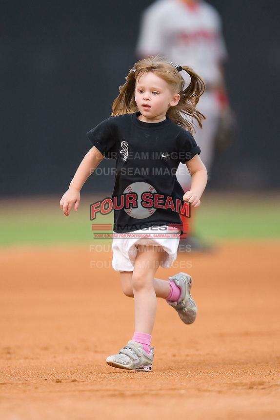 The niece of Winston-Salem Warthogs Catcher Billy Killian (24) runs the bases in the mascot race at Ernie Shore Field in Winston-Salem, NC, Saturday August 9, 2008. (Photo by Brian Westerholt / Four Seam Images)