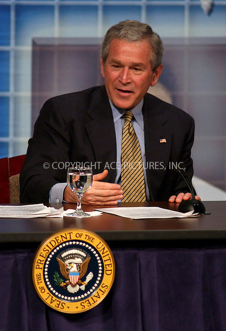 WWW.ACEPIXS.COM . . . . . ....BRIDGEPORT, CONNECTICUT, APRIL 5, 2006....US President George W. Bush listens to a panelist during a town hall style meeting on Health Savings Accounts .....Please byline: KRISTIN CALLAHAN - ACEPIXS.COM.. . . . . . ..Ace Pictures, Inc:  ..(212) 243-8787 or (646) 679 0430..e-mail: info@acepixs.com..web: http://www.acepixs.com