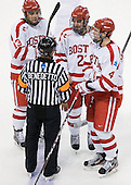Garrett Noonan (BU - 13), Sean Escobedo (BU - 21) and Patrick MacGregor (BU - 4) chat with Tim Benedetto after the game. - The Boston University Terriers defeated the visiting Providence College Friars 6-1 on Friday, January 20, 2012, at Agganis Arena in Boston, Massachusetts.