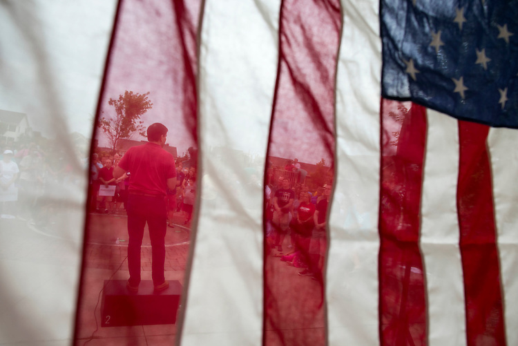 UNITED STATES - August 17: Republican presidential candidate Sen. Marco Rubio, R-Fla., speaks during a Family Night event at Dean Park, as seen from behind an American flag, in Ankeny, Iowa, Monday, August 17, 2015. (Photo By Al Drago/CQ Roll Call)