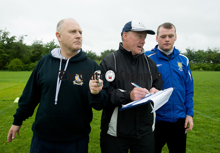 Tommy Molloy, schoolboys soccer chairman and Martin Hehir  and Jamie Lynch, joint team managers counting hits and timing the event during the Clare Kennedy Cup squad's world record attempt at hitting the crossbar as many times as possible in one hour. Photograph by John Kelly.