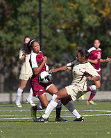 Boston College forward Natalie Crutchfield (9) blocks progress of Florida State midfielder Casey Short (3). Florida State University defeated Boston College, 1-0, at Newton Soccer Field, Newton, MA on October 31, 2010.