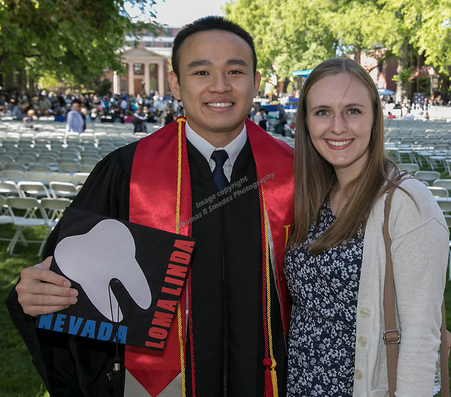 Eric Tran and Paige Arcieri during the University of Nevada College of Agriculture, Biotechnology & Natural Resources and College of Education graduation ceremony on Friday evening, May 19, 2017.
