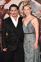Johnny Depp &amp; Mia Wasikowska at the premiere of &quot;Alice Through the Looking Glass&quot; at the Odeon Leicester Square, London.<br /> May 10, 2016  London, UK<br /> Picture: Steve Vas / Featureflash