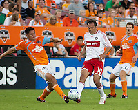 Chicago Fire midfielder Cuauhtemoc Blanco (10) attempts to tap the ball out of reach of Houston Dynamo forward Brian Ching (25).  Houston Dynamo defeated Chicago Fire 3-2  at Robertson Stadium in Houston, TX on August 9, 2009.