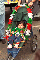 Spectator age 2 fully decorated at Cinco de Mayo festival.  St Paul Minnesota USA