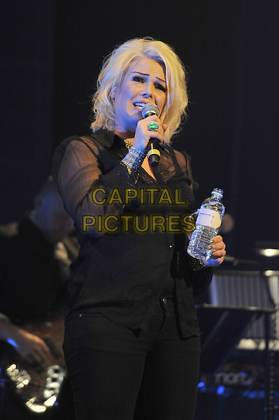 Kim Wilde.British Electric Foundation (B.E.F) at the Roundhouse, Camden, London, England..15th October 2011.performing performance live in stage on concert music gig half length black sheer blouse singing bottle water .CAP/MAR.© Martin Harris/Capital Pictures.