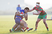 Sione Hifo looks as if he is enjoying himself as he is tackled to the ground. Counties Manukau Premier Club Rugby game between Waiuku and Ardmore Marist, played at Waiuku on Saturday June 4th 2016. Ardmore Marist won 46 - 3 after leading 39 - 3 at Halftime. Photo by Richard Spranger.