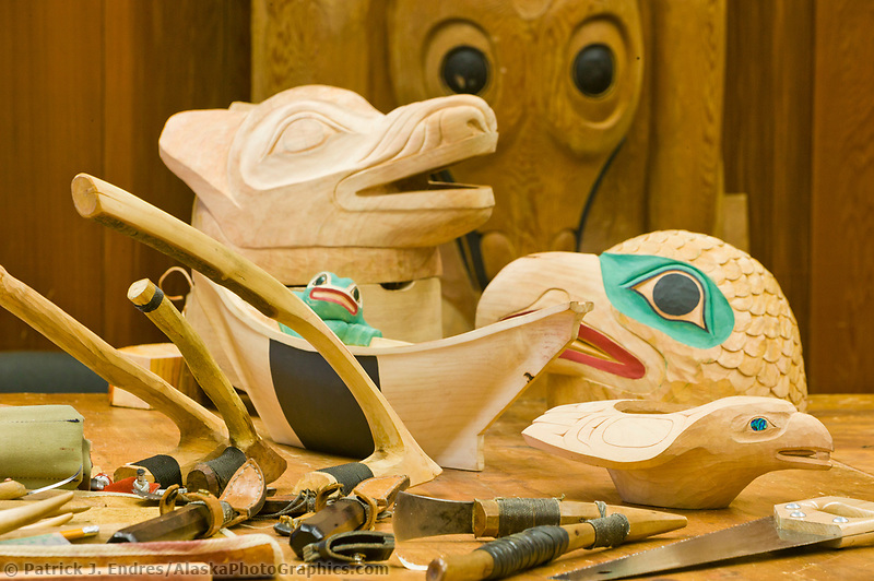 Carved masks and tools of Tlingit Woodcarver, Tommy Joseph at the Sitka National Historic Park in the coastal town of Sitka, Alaska