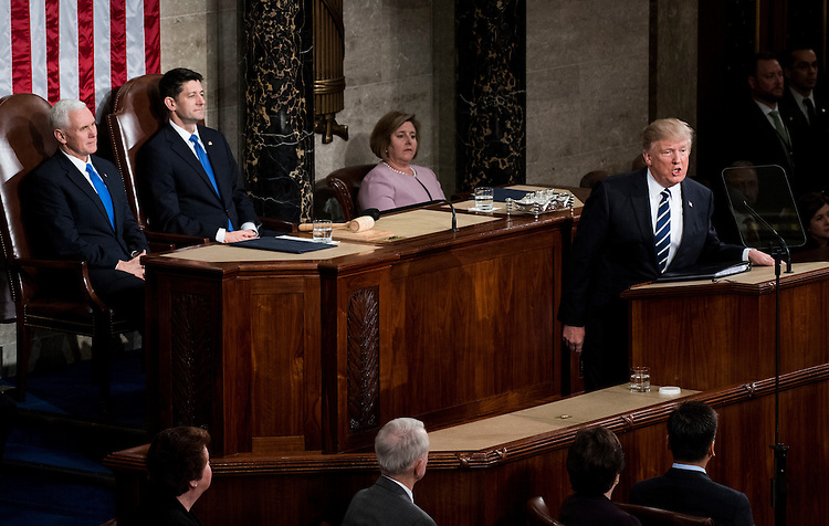 UNITED STATES - FEBRUARY 28: Vice President Mike Pence and Speaker of the House Paul Ryan, R-Wisc., listen as President Donald Trump delivers his address to a joint session of Congress on Tuesday, Feb. 28, 2017. (Photo By Bill Clark/CQ Roll Call)