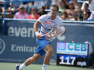 Washington, DC - August 3, 2014: Vasek Pospisil of Canada runs to return a shot in the Citi Open final at the Fitzgerald Tennis Center, August 3, 2014. Fellow Canadian Milos Raonic won in straight sets over Pospisil.   (Photo by Don Baxter/Media Images International)