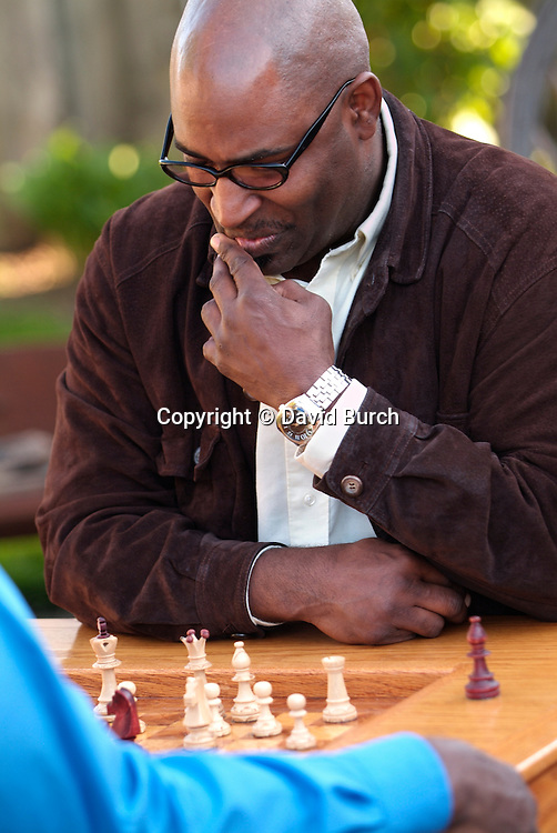 African American man playing chess