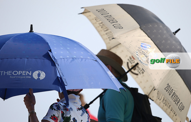 Wales is a proud nation having staged the Ryder Cup in 2010, and there are hopes for The Open to be played at Royal Porthcawl, umbrellas during Round One of the 2014 Senior Open Championship presented by Rolex from Royal Porthcawl Golf Club, Porthcawl, Wales. Picture:  David Lloyd / www.golffile.ie