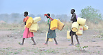 Girls in Yei, Southern Sudan, walk to a well to get water. NOTE: In July 2011, Southern Sudan became the independent country of South Sudan