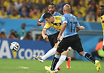 (L-R) Alvaro Pereira (URU), James Rodriguez (COL), Egidio Arevalo (URU),<br /> JUNE 28, 2014 - Football / Soccer :<br /> James Rodriguez of Colombia scores the opening goal past Alvaro Pereira and Egidio Arevalo of Uruguay during the FIFA World Cup Brazil 2014 Round of 16 match between Colombia 2-0 Uruguay at Estadio do Maracana in Rio De Janeiro, Brazil. (Photo by SONG Seak-In/AFLO)