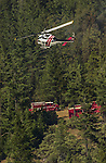 August 22, 2001 Coulterville, California  -- Creek Fire – CDF helicopter just dropped water on Cuneo Road hot spot beyond CDF crew carriers.  The Creek Fire burned 11,500 acres between Highway 49 and Priest-Coulterville Road a few miles north of Coulterville, California.