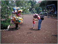 A mother buys a balloon for her daughter in Lincoln Park in Polanco Mexico City.