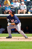 Alden Carrithers (24) of the Gwinnett Braves attempts a bunt against the Charlotte Knights at Knights Stadium on July 28, 2013 in Fort Mill, South Carolina.  The Knights defeated the Braves 6-1.  (Brian Westerholt/Four Seam Images)